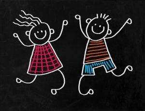 Vidám táncoló fiú és lány krétarajza